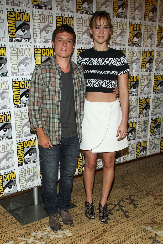 Jennifer Lawrence stayed close to her Catching Fire costar Josh Hutcherson at the film's Comic-Con event.