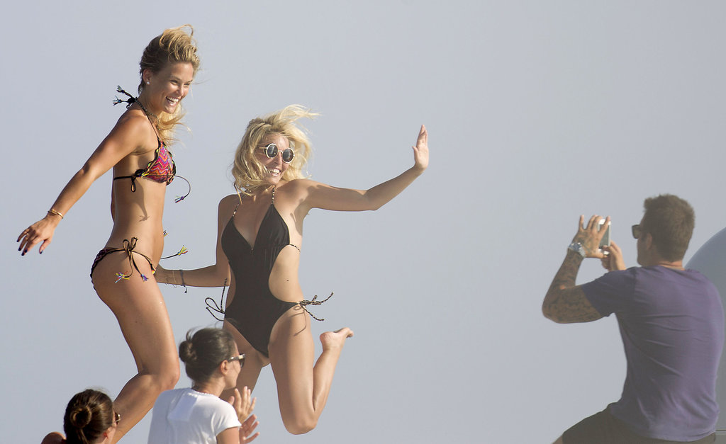 Bar Refaeli and her friend took jumping photos.