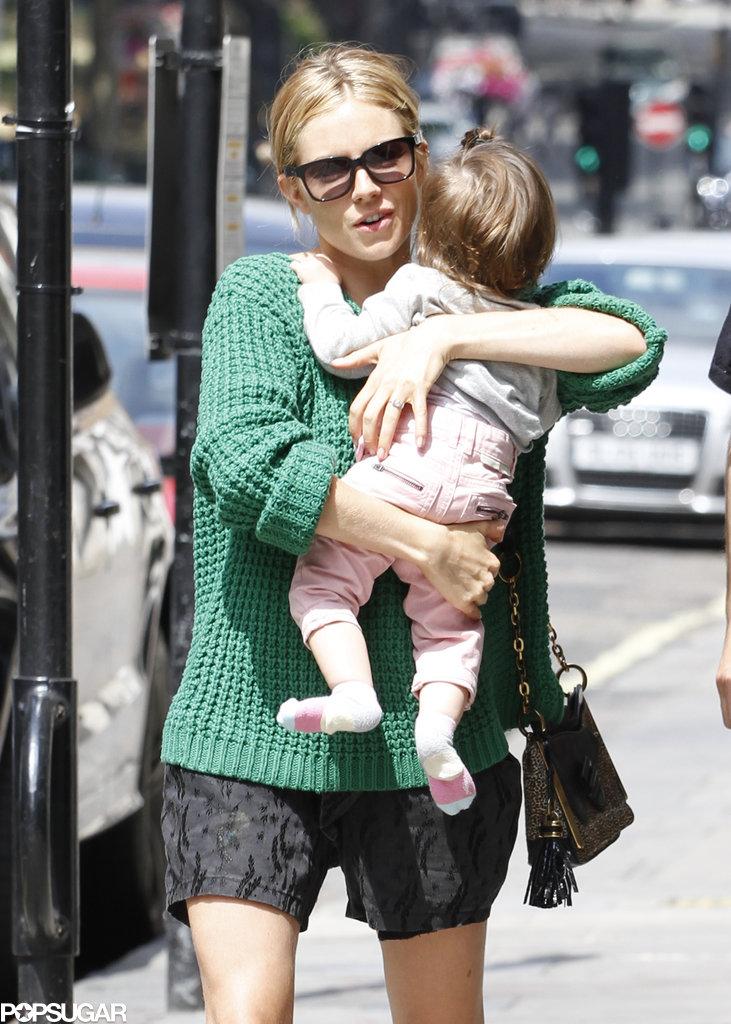 Sienna Miller held on to her daughter, Marlowe Sturridge.