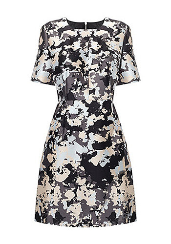 While Kate doesn't often veer from classic styles and silhouettes, we could see the new mom experimenting with a splashy print like this Whistles option ($272).