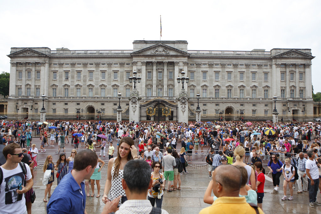 Crowds braved a rainy day to visit Buckingham Palace following the royal baby's birth.