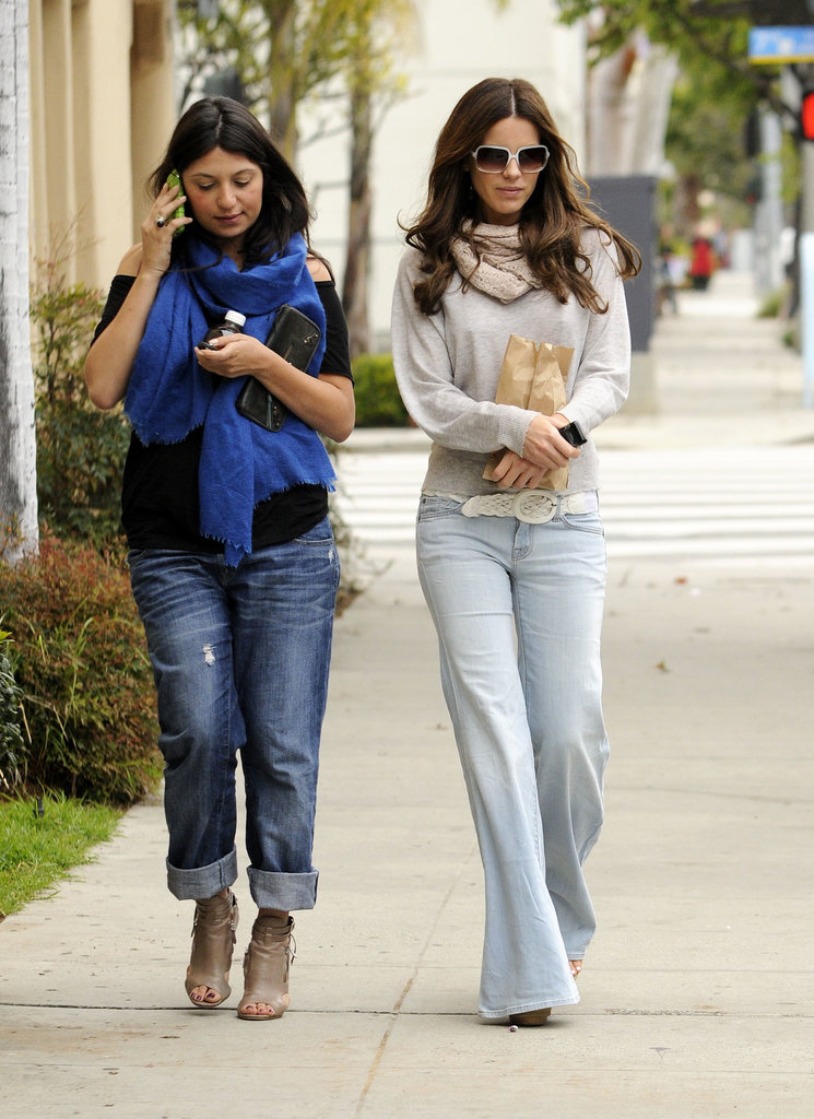 The brunette beauty was Spring-ready in light-wash bell bottom jeans, a cozy oatmeal sweater, and beige scarf while cruising around Santa Monica with a friend in February 2010.