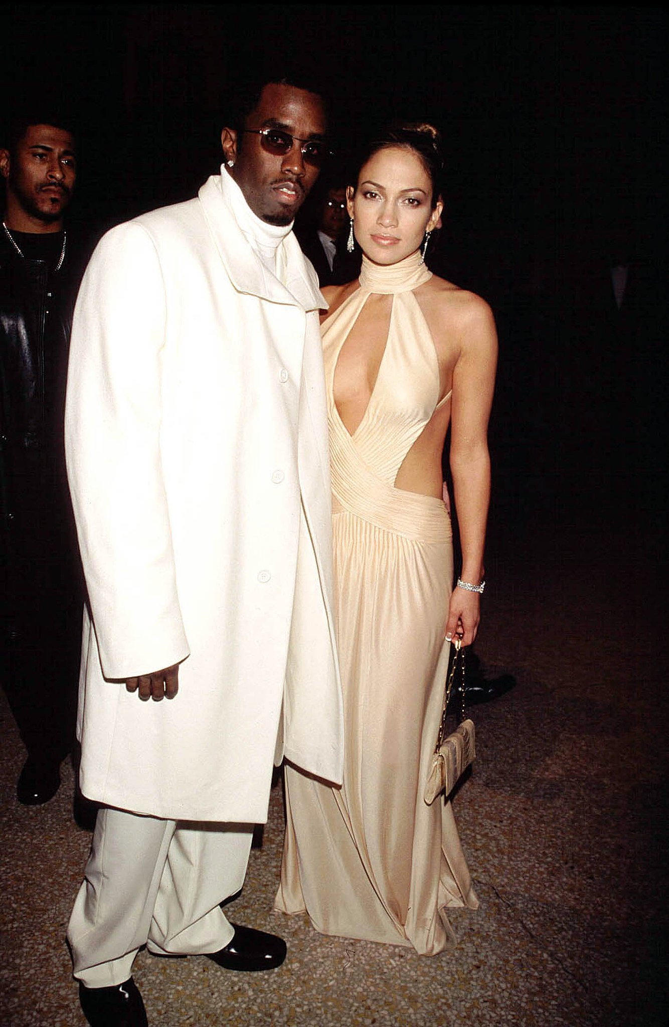 Stepping out with Diddy in a revealing cutout gown at the Met in '99.