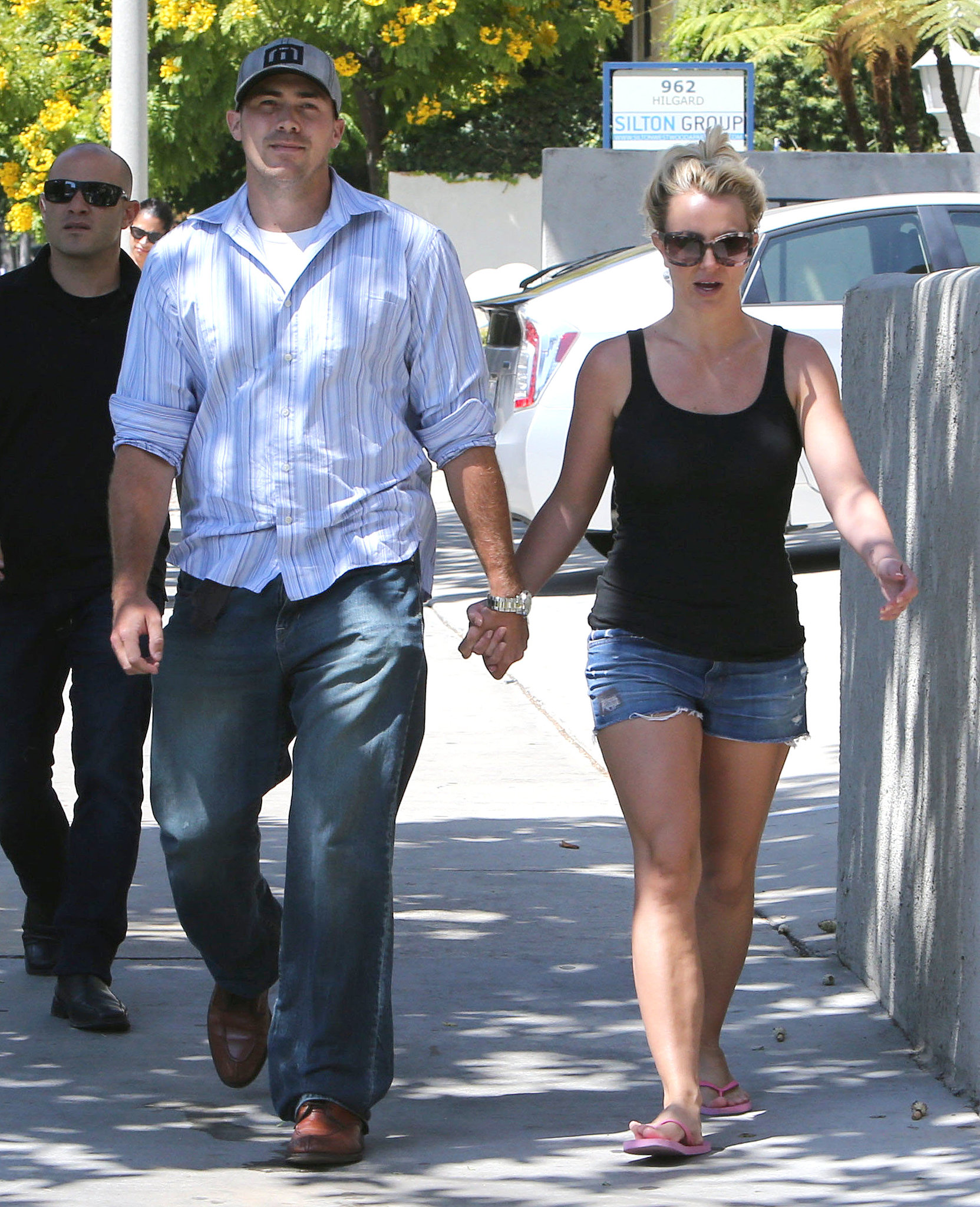 Britney Spears wore a black tank top and denim shorts.