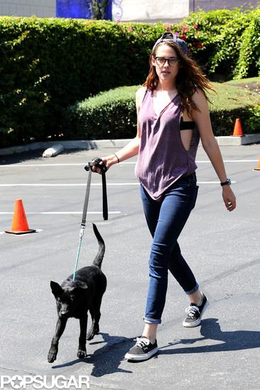 Kristen Stewart walked a black dog in LA and wore Vans tennis shoes.