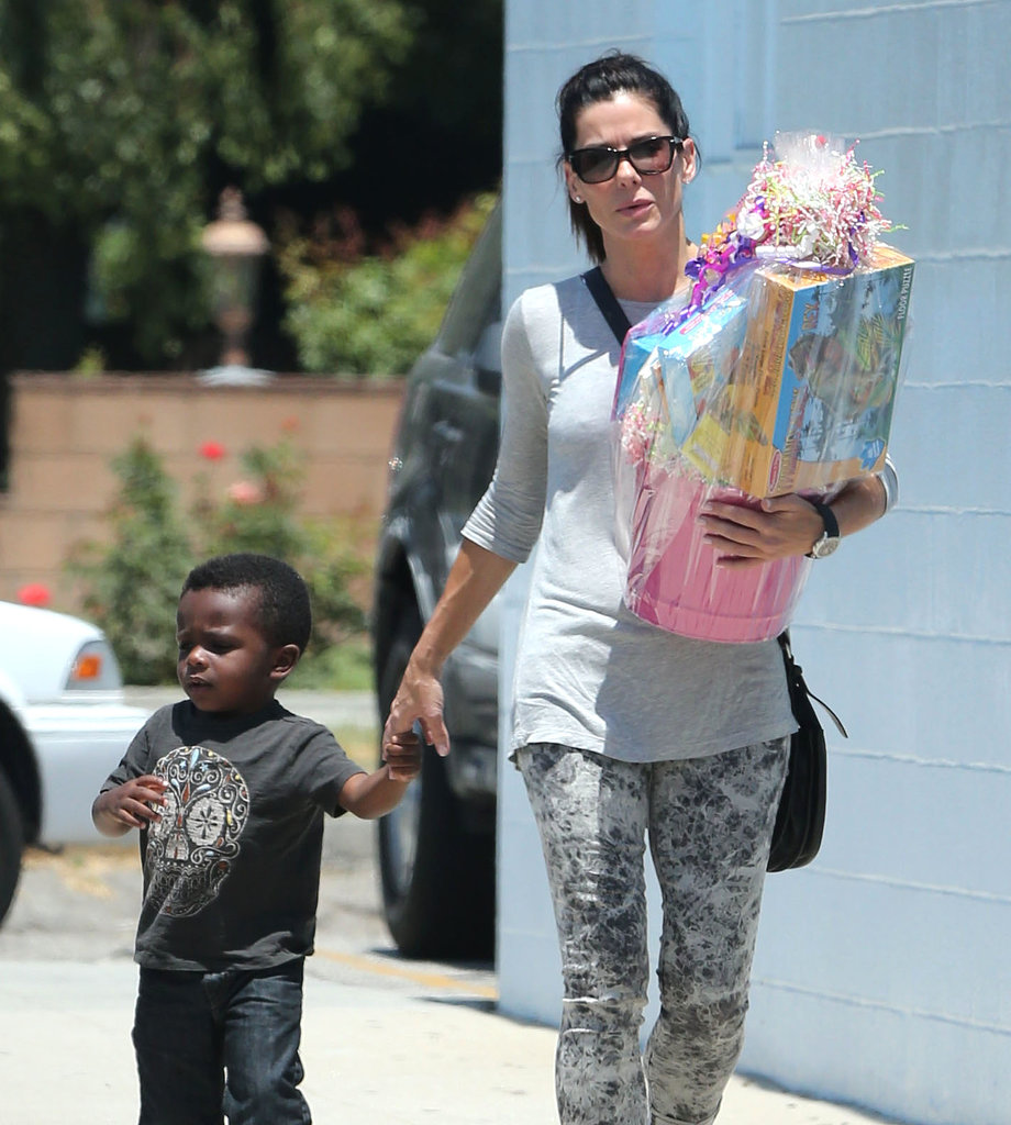 Sandra Bullock held hands with her son, Louis, on their way to a birthday party in LA.