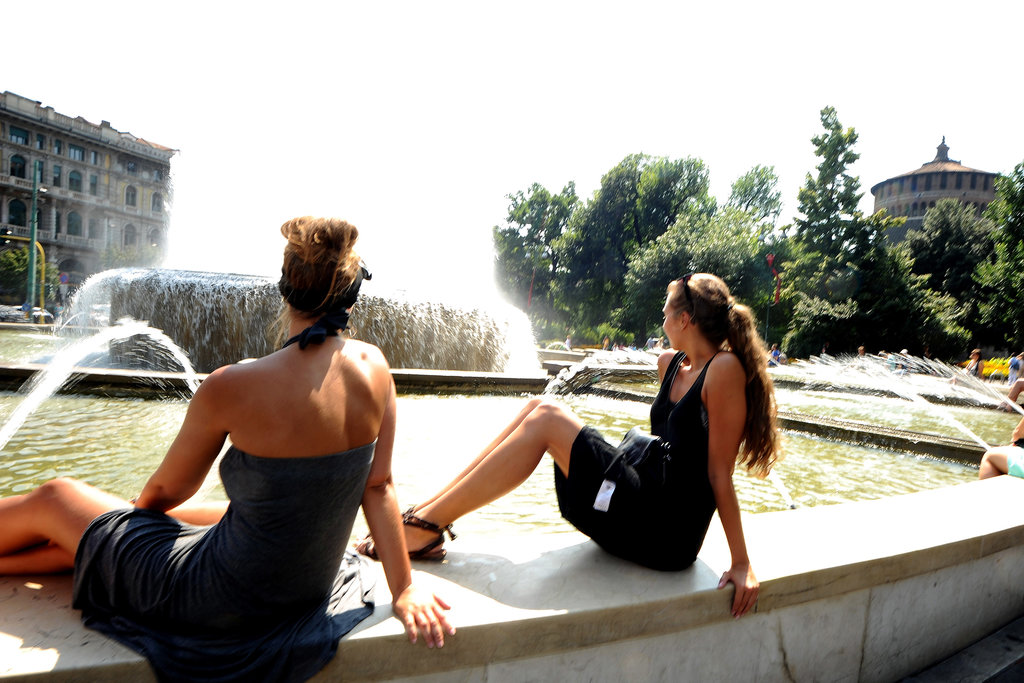 Women refreshed themselves at the Castello Sforzesco fountain during a late July heat wave in Milan, Italy.