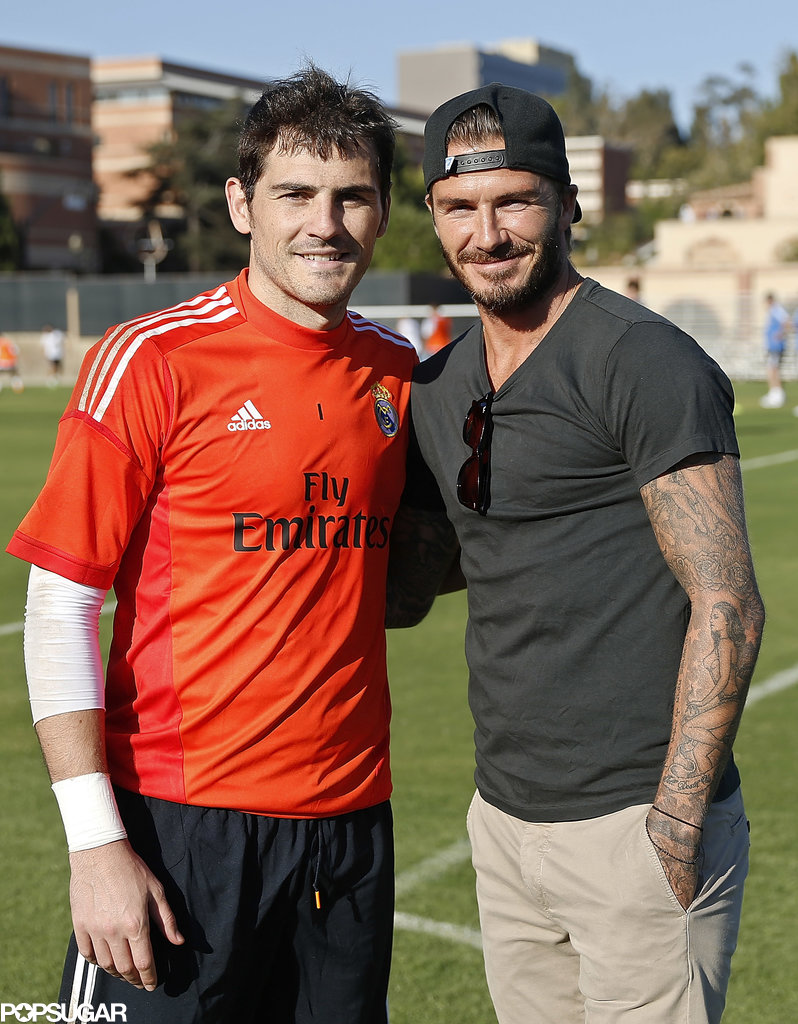 Real Madrid player Iker Casillas posed with David Beckham on the field.