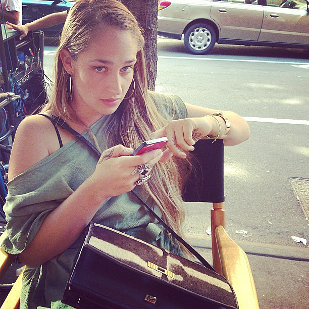 Lena Dunham took a photo of Jemima Kirke playing on her phone during a break from filming Girls. Source: Instagram user lenadunham