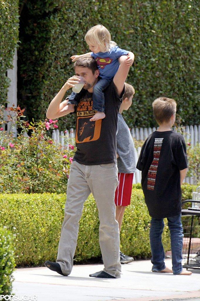 Matthew Bellamy held on to Bingham as he sipped lemonade.