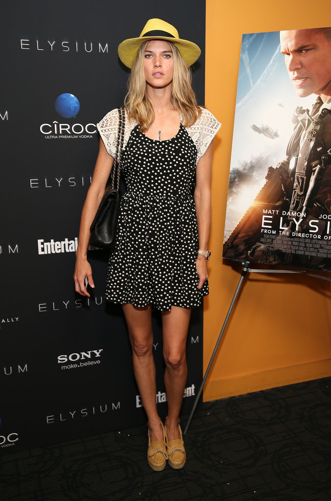 Byrdie Bell topped her summery dress with an oversize hat while screening Elysium in New York.