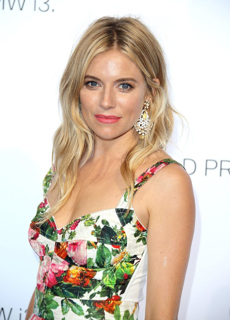 Stepping out in London for the BMW i3 Global Reveal Event, Sienna Miller looked amazing in a bold floral-print dress. She kept her beauty look simple with soft waves and minimal makeup that focused on a bright pink lipstick hue.