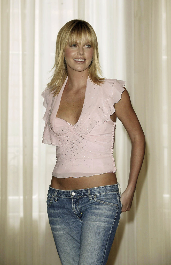 In September 2003, Charlize attended a press event in London in a pink top and low-cut jeans.