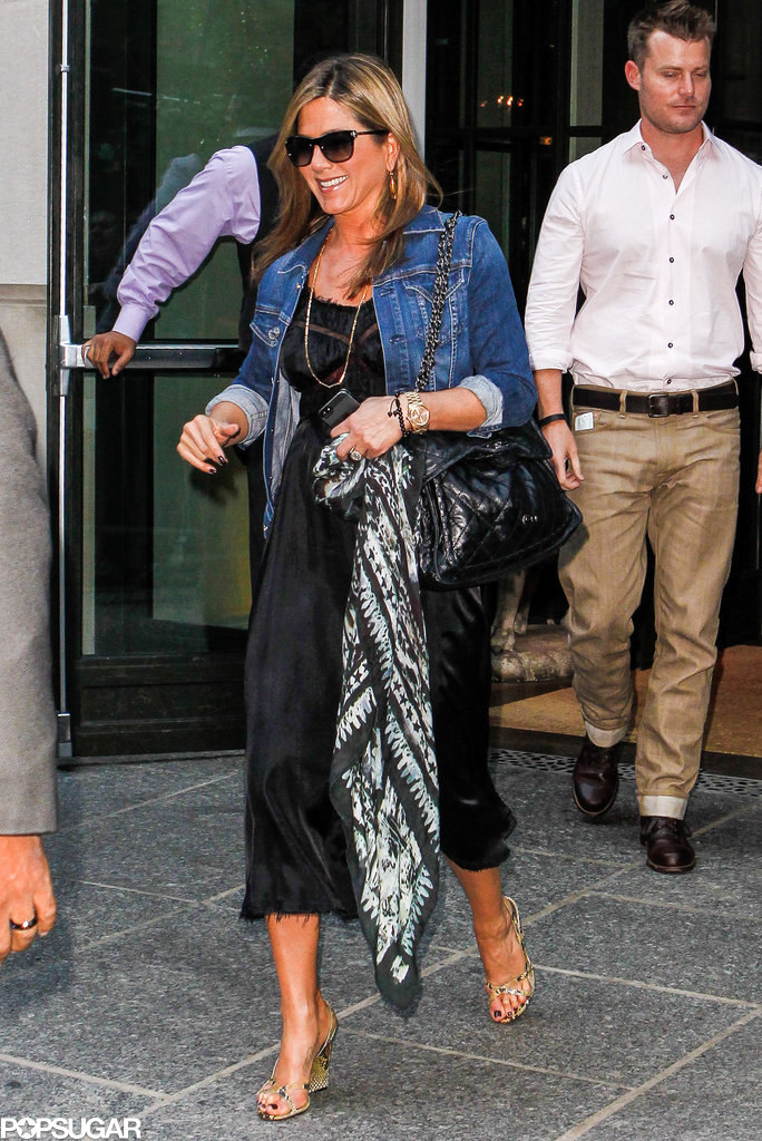 Jennifer Aniston smiled as she left the Crosby Street Hotel.