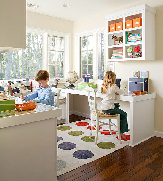 Creating back-to-back study spaces gives kids the space they need to do their work, while allowing them to collaborate when necessary.  Source: Better Homes and Gardens