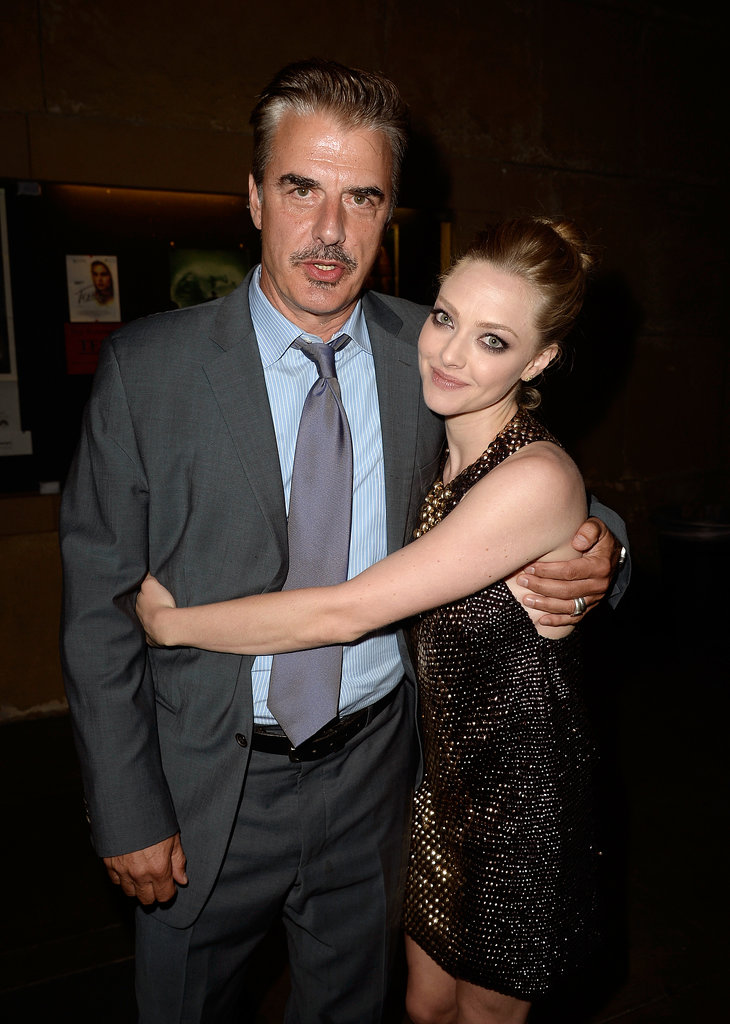Amanda Seyfried gave her costar Chris Noth a hug at their LA premiere of Lovelace.