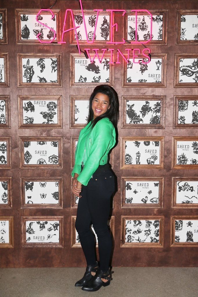 Hannah Bronfman accented her black pants with a bright green topper at the Saved Wines launch event.