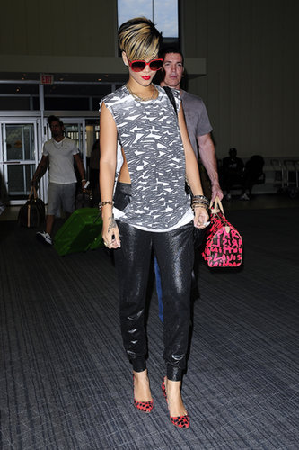 Leather joggers, a peekaboo muscle tee, and checkerboard pumps comprised Rihanna's 2009 travel style.