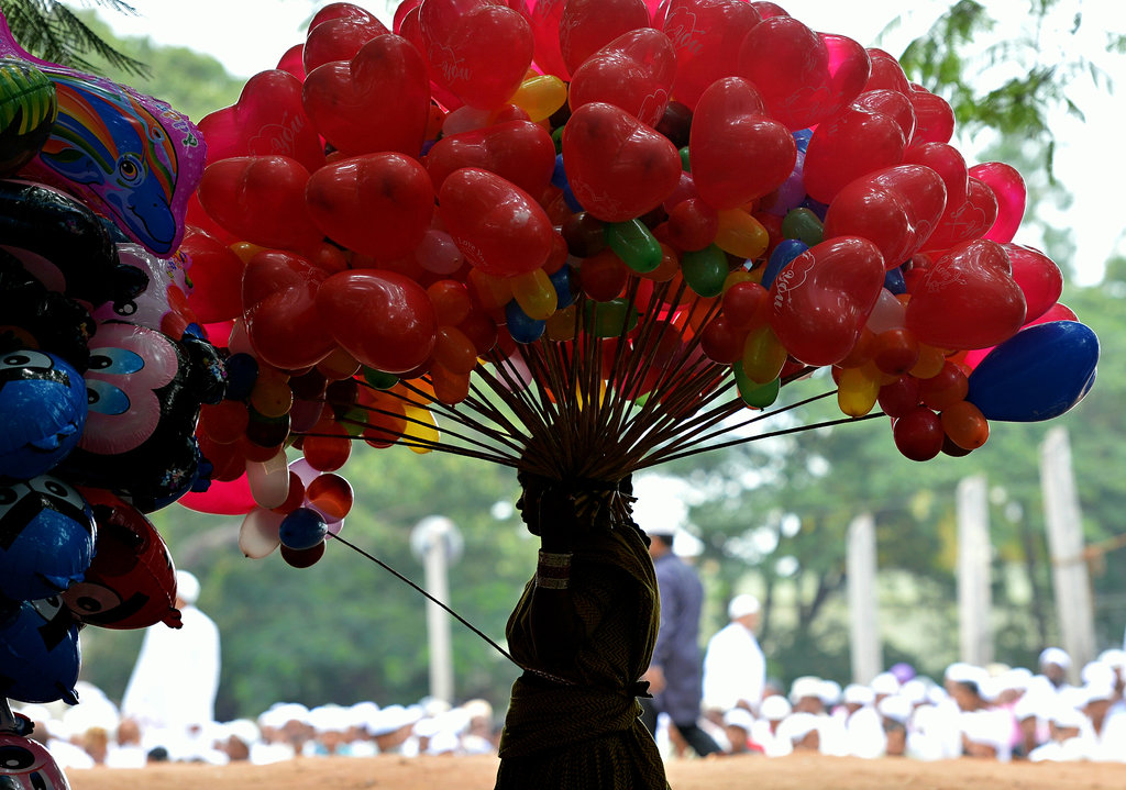 A vendor carried heart-shaped balloons through the streets of India as people prepared for the Eid al-Fitr celebrations.