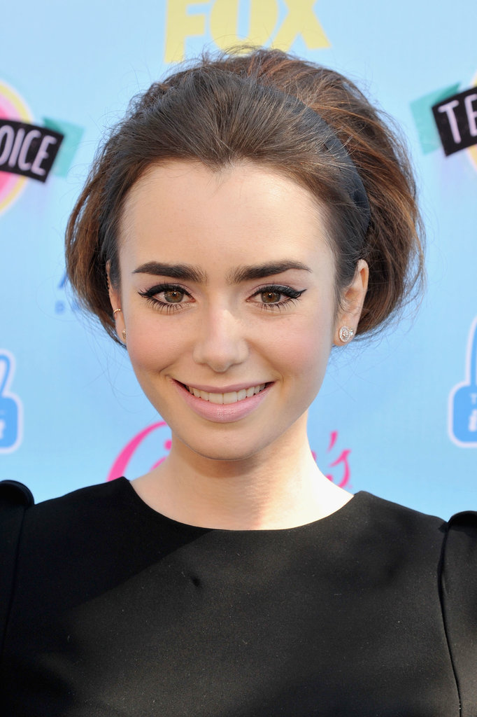 Lily Collins's Teen Choice Awards look was all about the drama. The actress opted for her signature bold brows, a flick of eyeliner, and a pop of pink lips. But it was her oversize, mid-height bun that really stole the show.