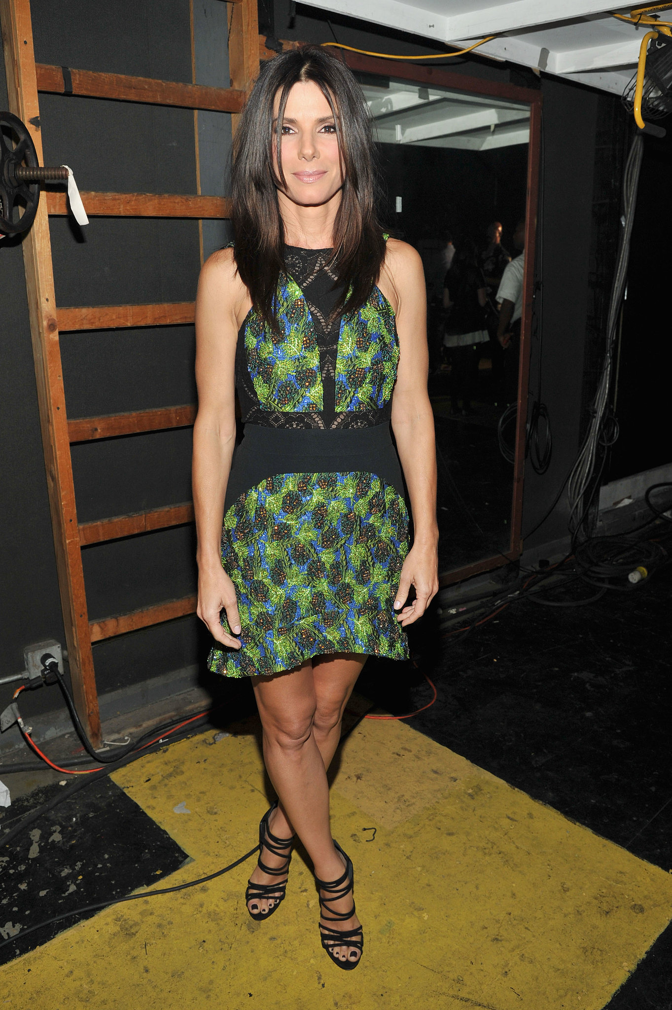 Sandra Bullock stepped backstage during the Teen Choice show in a contoured Antonio Berardi minidress and strappy Casadei sandals.