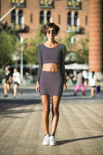 With abs like hers, it would be a shame not to employ the crop top trend.  Source: Le 21ème | Adam Katz Sinding