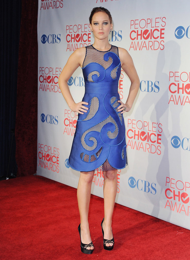 We don't know if it's the swirling sapphire hue or the fishnet detailing of her Viktor & Rolf dress, but we're loving every (slightly) aquatic reference in her 2012 People's Choice Awards outfit.
