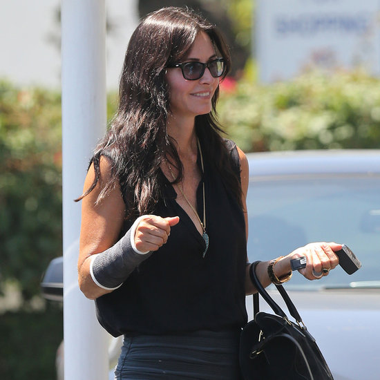 Courteney Cox Wearing a Cast