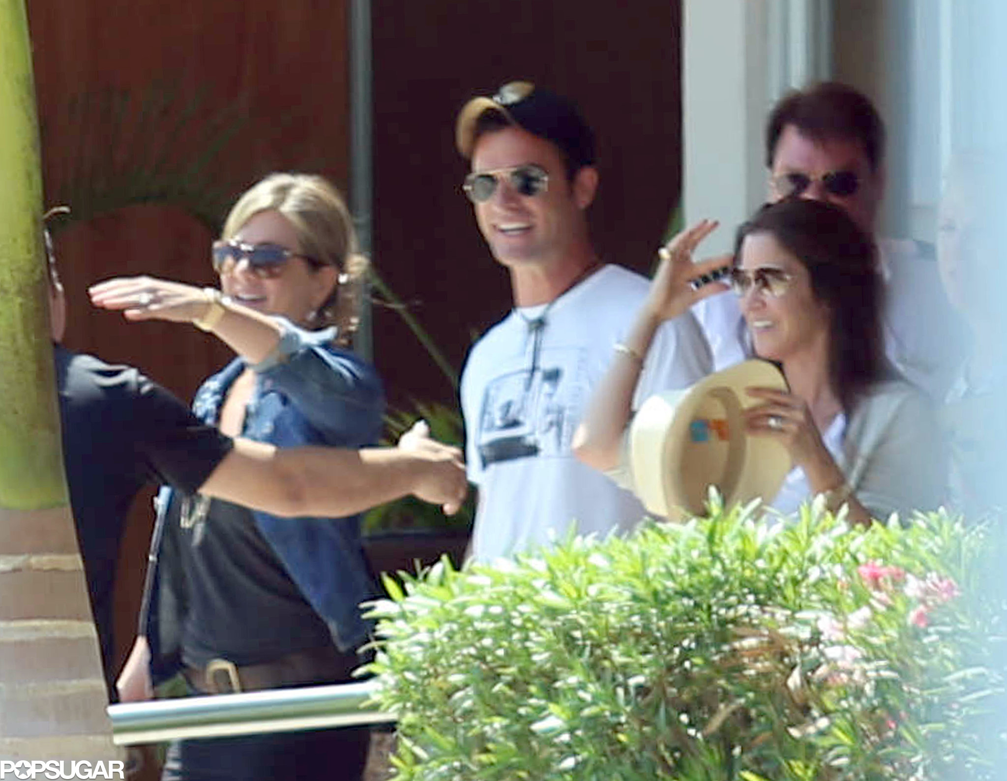 Jennifer Aniston and Justin Theroux sported big smiles as they arrived in Mexico.
