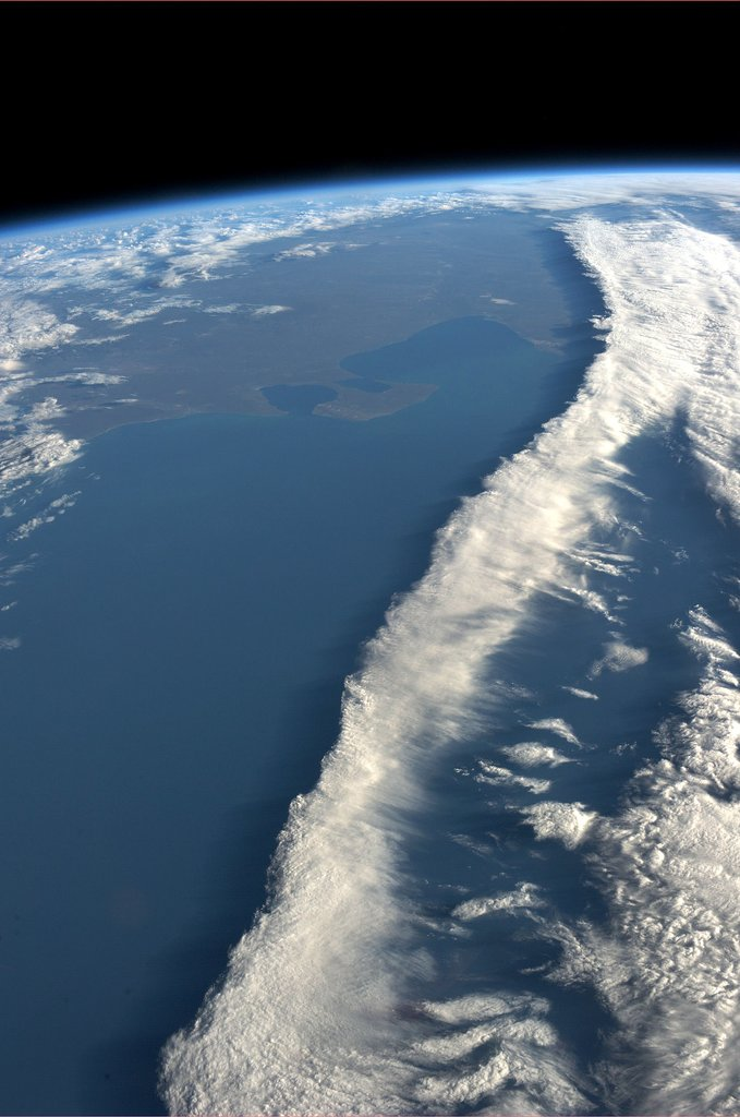 """""""A ribbon of clouds intersecting the coast of Argentina. Taken August 7, 2013. KN from space."""" Source: Pinterest user Karen Nyberg"""
