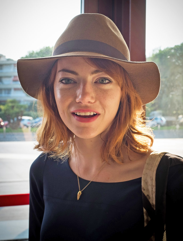 Emma Stone showed off her newly red strands earlier with a fedora and loose waves.