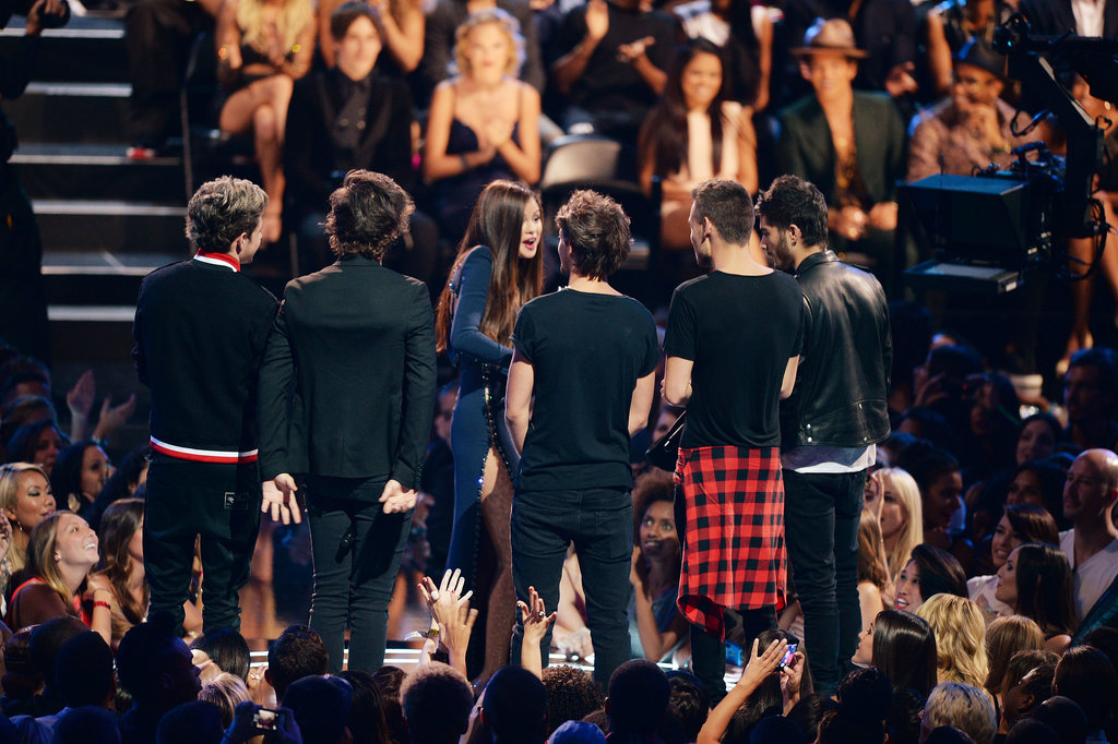 One Direction presented Selena Gomez with her award.