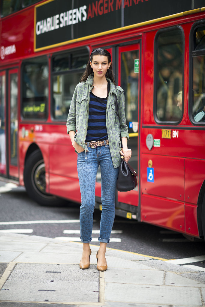 Ruby Aldridge mixed up her leopard-print jeans with a camo jacket for a cool-girl effect.  Source: Le 21ème | Adam Katz Sinding