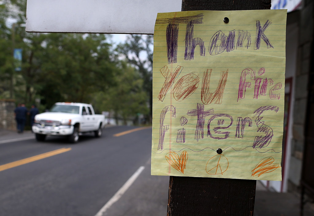 A homemade sign thanking local firefighters was displayed along the highway in Groveland, CA.