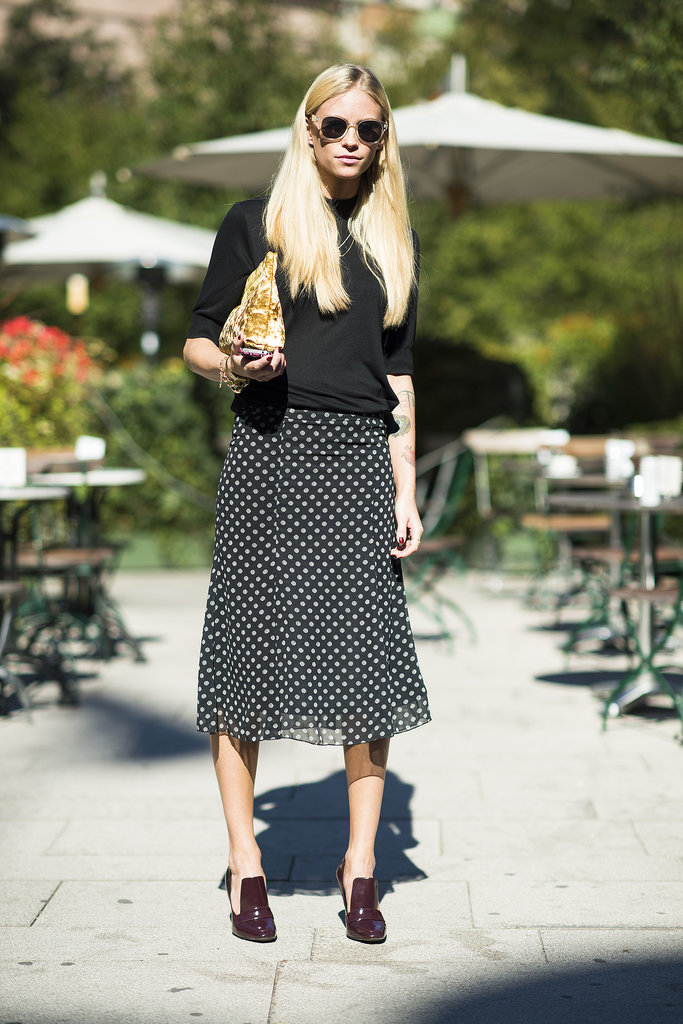 Embrace the ladylike dress code with a calf-length skirt, then give it the coolest kind of finish with just your shades. Source: Le 21ème | Adam Katz Sinding