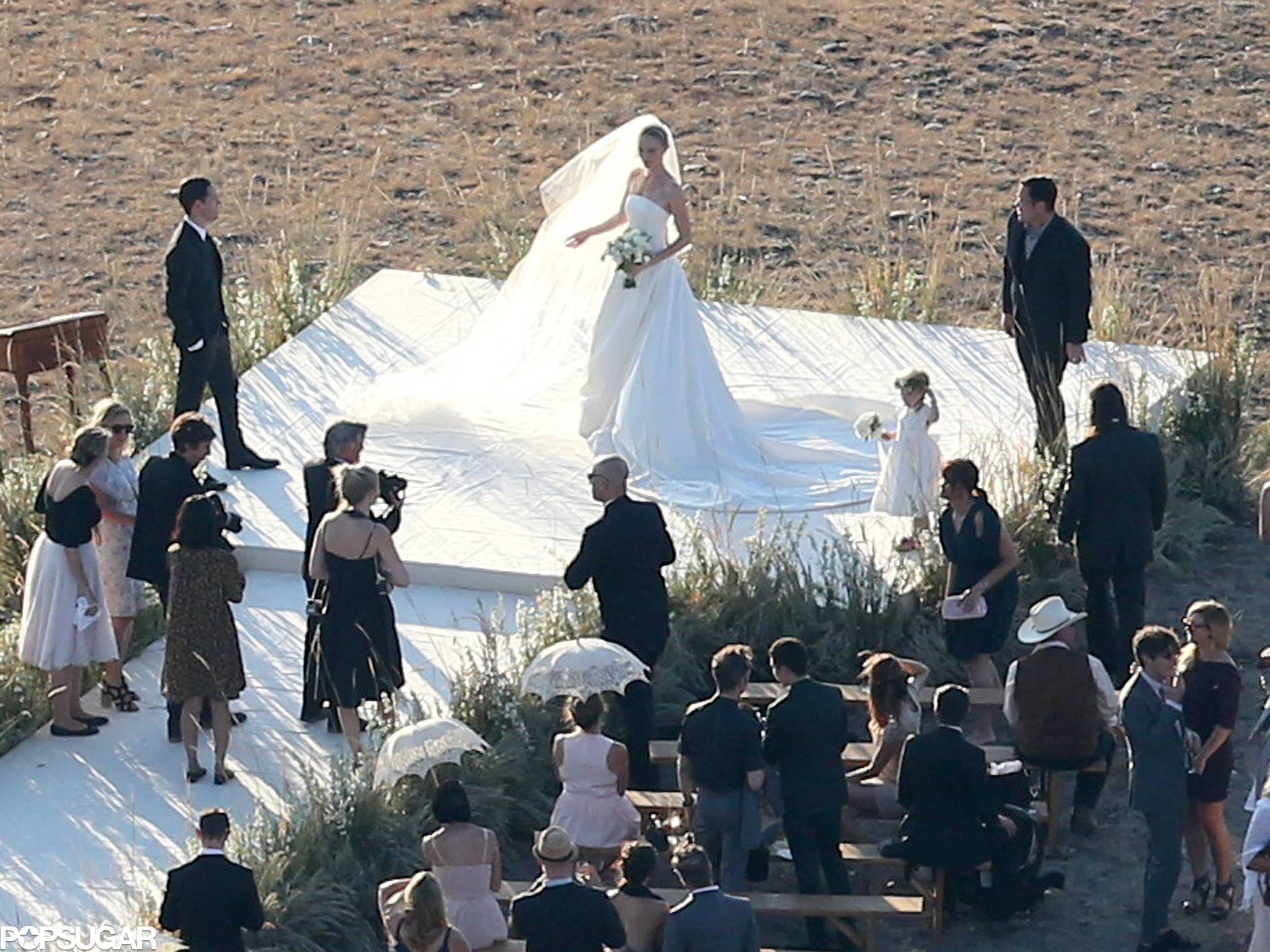 Kate Bosworth's veil caught the wind while she posed for pictures.