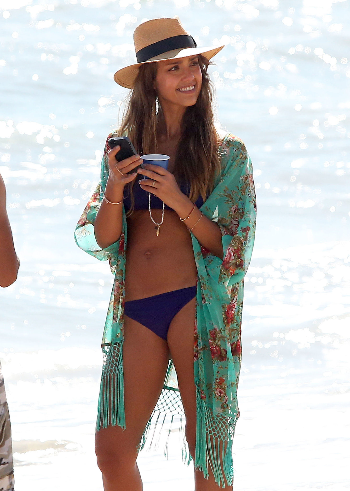 Jessica Alba smiled while hanging out in her bikini.