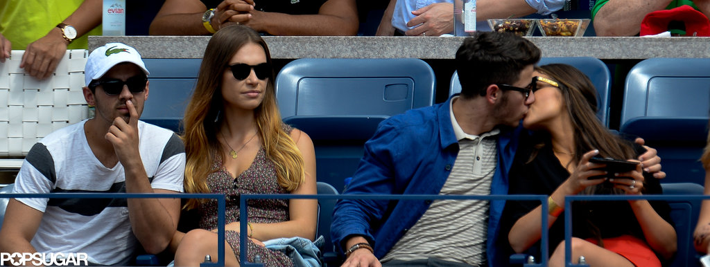 Nick Jonas and Joe Jonas watched the action with their girlfriends.