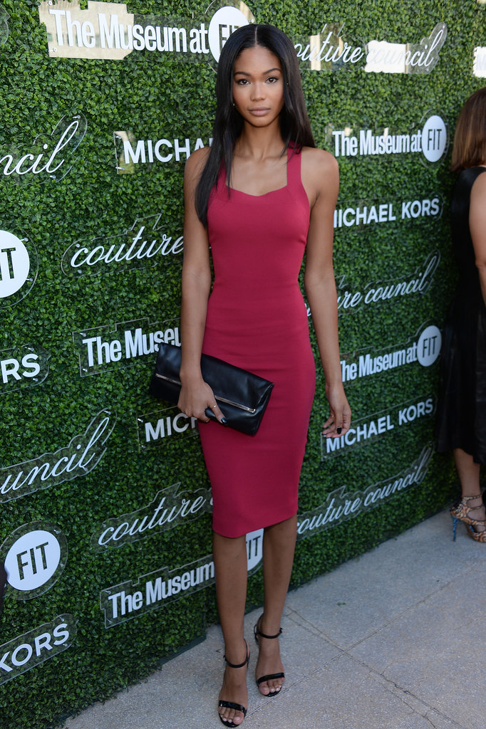 Chanel Iman put her svelte figure on display in a berry-hued Michael Kors sheath dress at the Couture Council Fashion Visionary Awards. She added a black clutch and ankle-strap sandals, also by Kors, to finish.