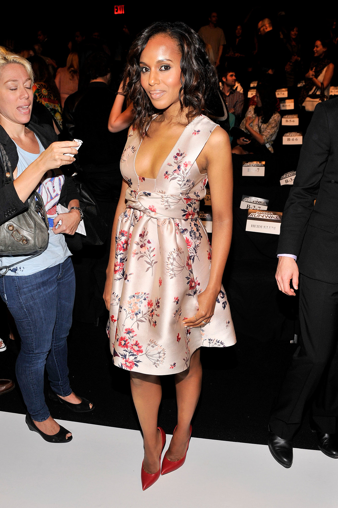 Kerry Washington looked part sweet, part sassy in a floral Stella McCartney dress and red Casadei pumps at the Project Runway show.