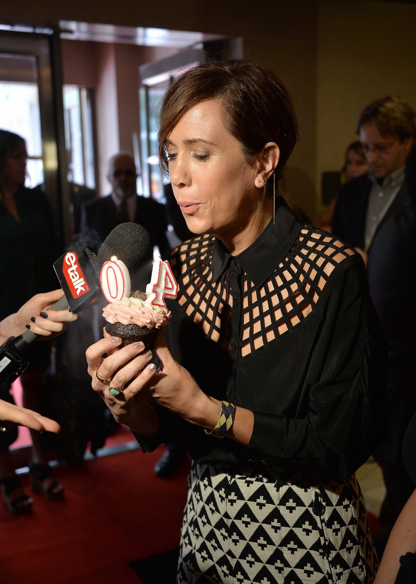 Kristen Wiig, who celebrated her 40th birthday last month, blew out candles on a cupcake.