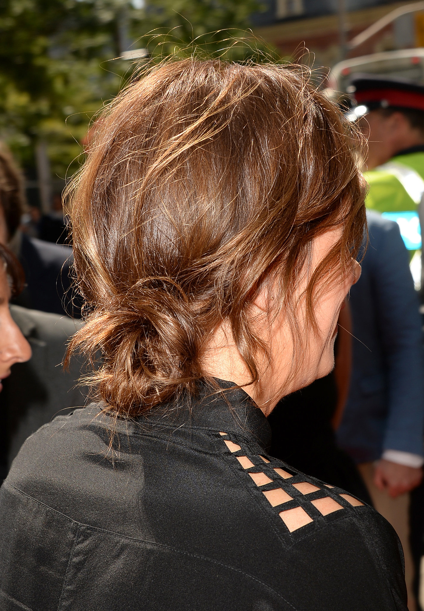 Here's Kristen Wiig donning a tousled, low-slung bun while walking the red carpet at t