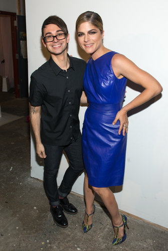 Selma Blair — sporting a bold, cobalt-blue dress and t-strap heels — took a moment to pose with Christian Siriano at his Spring 2014 show.
