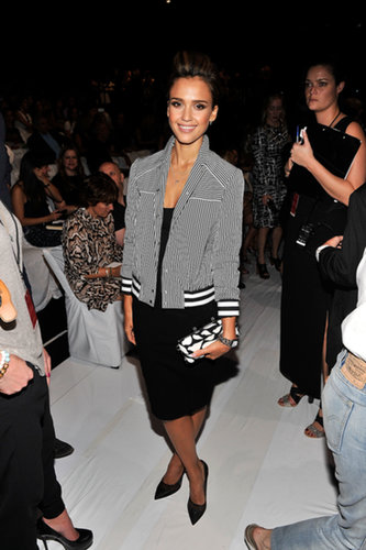 Jessica Alba combined chic with sporty in a striped bomber jacket and a little black dress at the Diane von Furstenberg show.