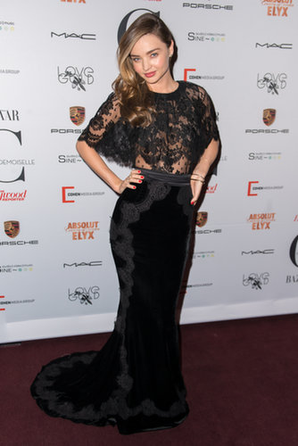 Miranda Kerr was sexy as ever in a black lace Dolce & Gabbana gown at the Mademoiselle C premiere.
