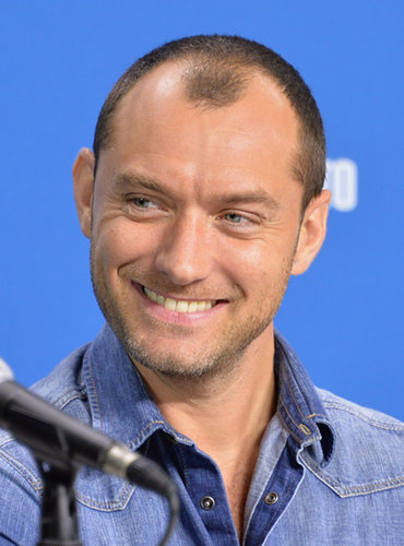Jude Law flashed a grin during the Dom Hemingway press conference.