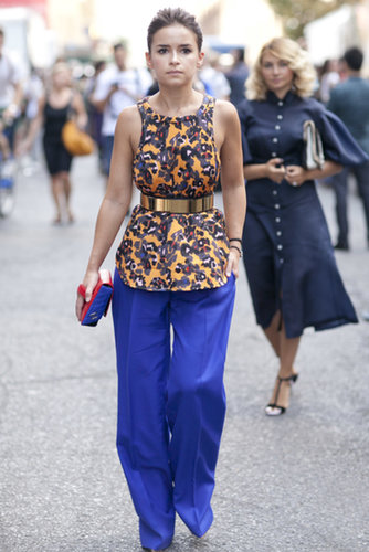 Miroslava went bold in a printed blouse, wide-leg pants, and a colorblock Chanel in hand.