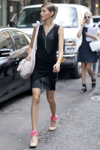 A sporty mix, from her zippered LBD to her Wang bag and high-tops.