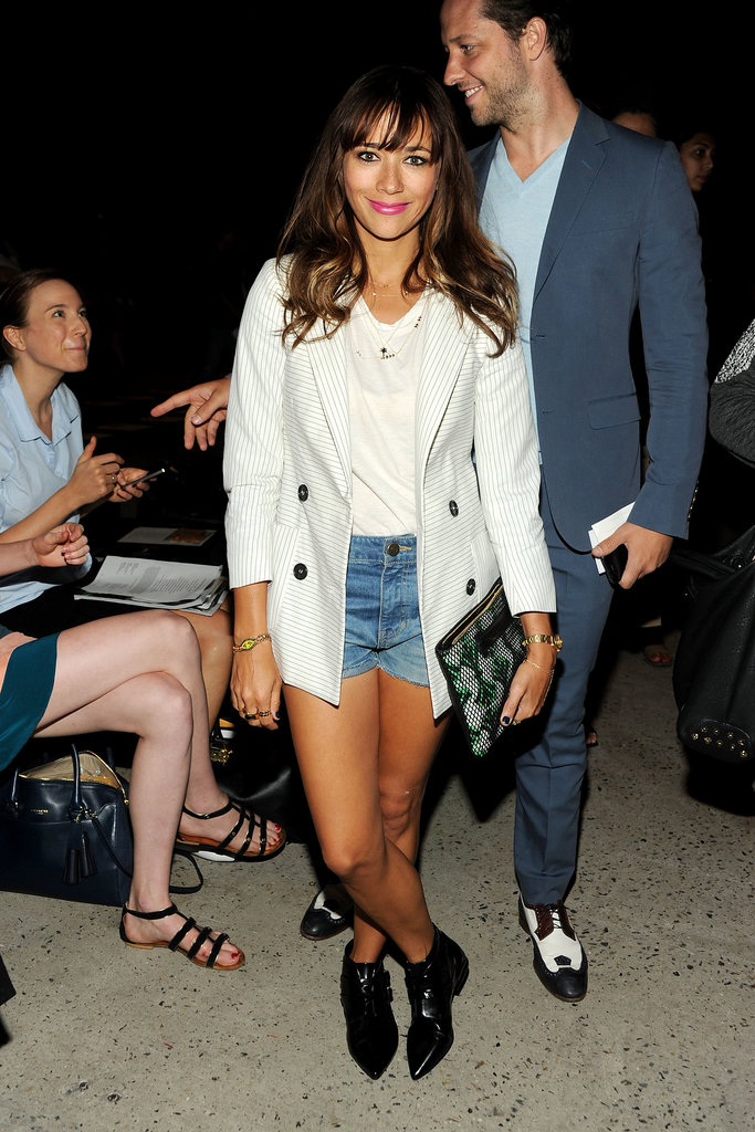 Rashida Jones dressed up her denim cutoffs with a striped blazer and black booties at Band of Outsiders.