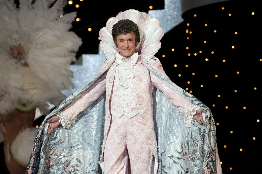 Outstanding Lead Actor in a Miniseries or Movie At the center of Liberace biopic Behind the Candelabra, Michael Douglas commands the spotlight. As the famously closeted entertainer, he plays the piano feverishly, coos at his lover (Matt Damon), and sparkles on stage. While Damon (who's also nominated) is great, Douglas is brilliant as he positively transforms himself.